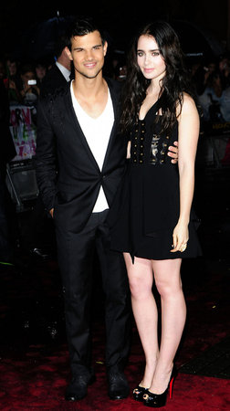 Taylor Lautner and Lily in London