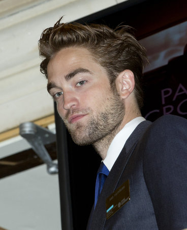Robert Pattinson Rings the Bell