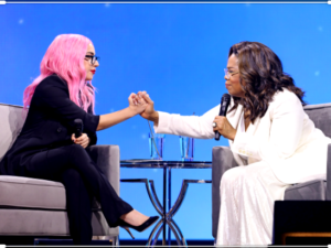 Lady Gaga and Oprah Winfrey hold hands